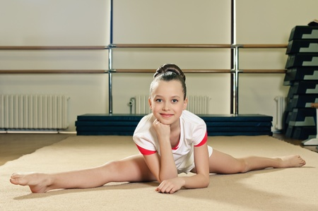 tights: portrait of young beauty gymnast in gymnasium