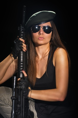 machinegun: young beauty girl with machine-gun on black background Stock Photo