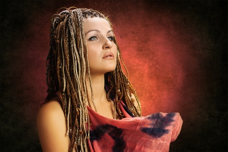 portrait of beautiful girl with african plaits on red gradient photo