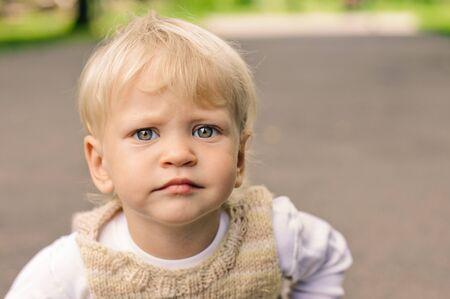 sympathetic: little sympathetic boy looking at the camera