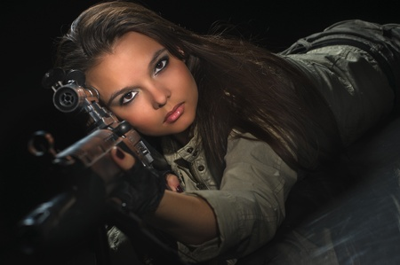 sexy army girl: young beauty girl with machine-gun on black background Stock Photo