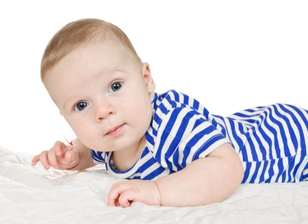 months: baby lies on stomach with white background