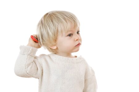two years: two years old blond boy in white sweater on white background