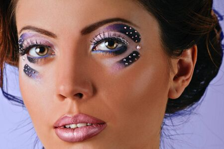 portrait of beautiful girl with art make up on lilac background Stock Photo - 14153727