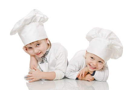 aprons: two kids in image of scullion on white Stock Photo