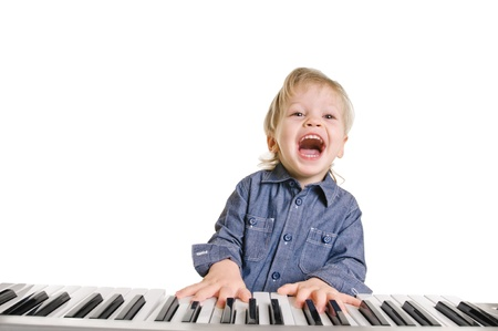 playing and singing little boy on white background