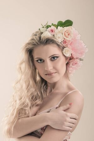 portrait of beautiful girl with rose in hair photo