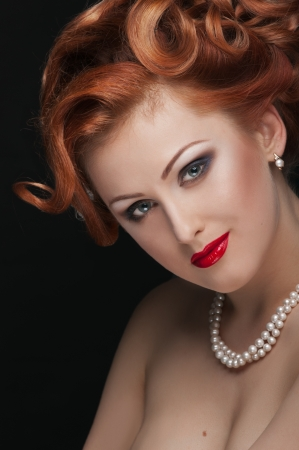 portrait of redheaded beautiful girl on black photo