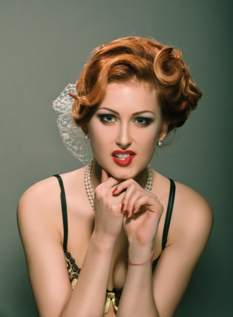 portrait of redheaded beautiful girl on dirty green photo