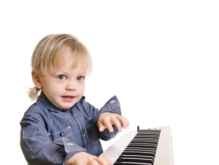playing and singing little boy on black background     photo