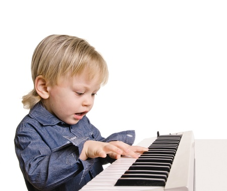 little boy and the keyboard on white background     photo