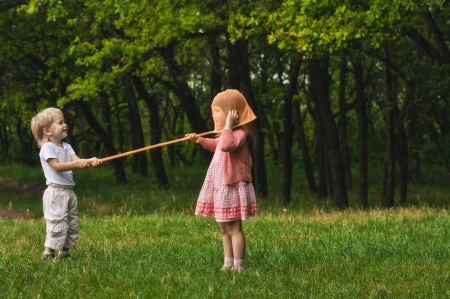 butterfly net: playing children with butterfly net in the forest Stock Photo