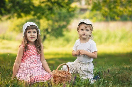 frendship: little girl and boy in the forest with punnet