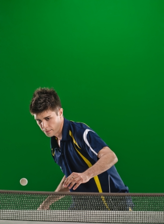 table tennis: young man tennis-player in play on chroma key