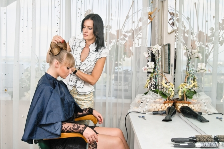 woman making a coiffure in hairdressing saloon