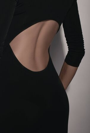 low neck of black dress with back of woman photo