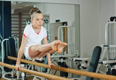 gymnastics sports: portrait of young beauty gymnast in gymnasium Stock Photo