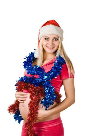 young happy pregnant woman in santa claus cap with new year decoration photo