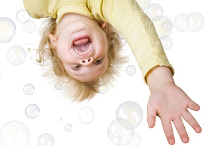 little boy and soap bubbles on white background Stock Photo - 16859709