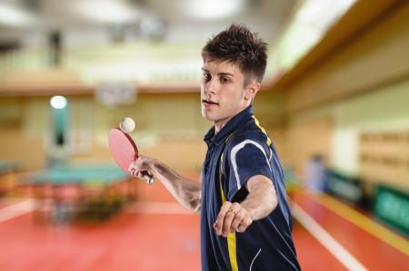 young man tennis-player in play on chroma key photo