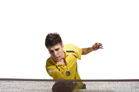 young man tennis-player in play on white background photo