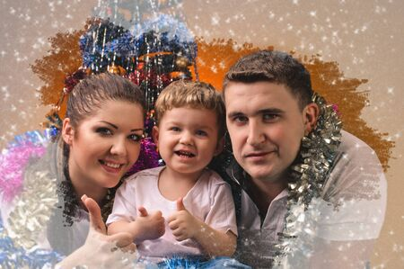 farther: young mother little boy and young farther in decorations of new year with frozen window effect Stock Photo