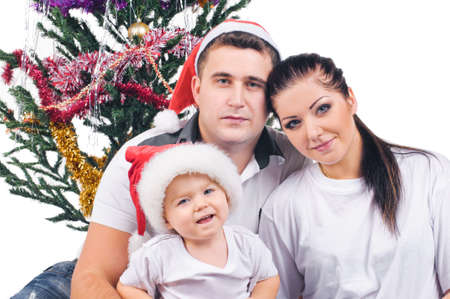 farther: young mother little boy and young farther in decorations of new year on white
