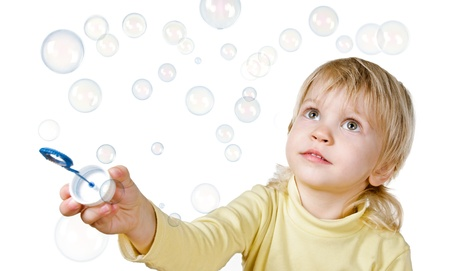 little boy and soap bubbles on white background Stock Photo - 17252716