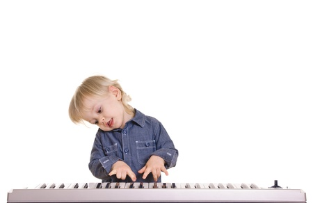 playing and singing little boy on black background