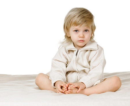 portrait of blond boy three or four years old on white