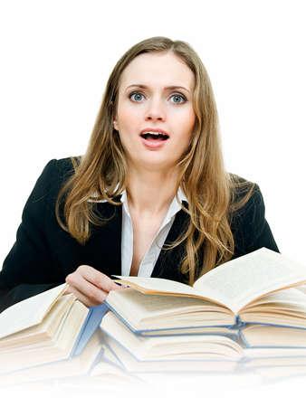 astonished pretty woman among books on white photo