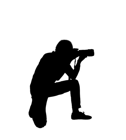 silhouette of man photographer on white background photo