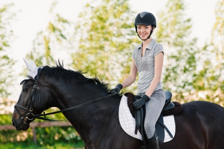 riding young woman portrait on horse in outdoor Stock Photo