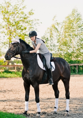 riding young woman portrait on horse in outdoor photo