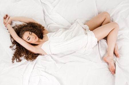 young woman on bed photo
