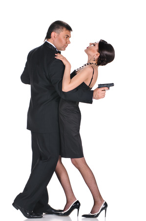 man in black suit and woman in black dress on white background photo