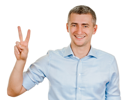 young man shows sign and symbol by hands on white background photo