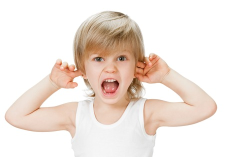 little boy stops ears from loud sound on white background photo