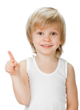 little boy shows sign and symbol on white background photo