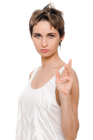 deplorable: portrait of young woman on white background Stock Photo