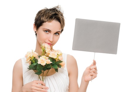 portrait of young woman with copy space tablet and flowers on white photo