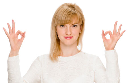 young woman shows sign and symbol ok on white background Stock Photo