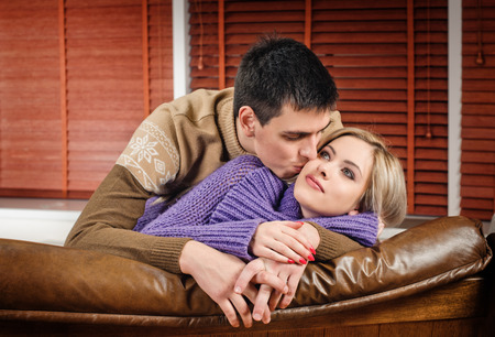 young couple in love at the apartment photo