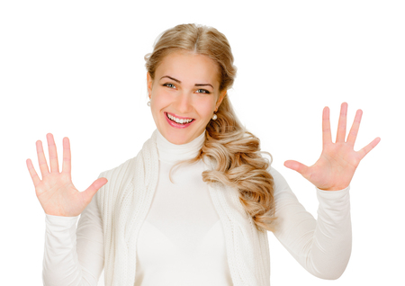Portrait of happy smiling woman showing ten fingers, isolated over white  photo