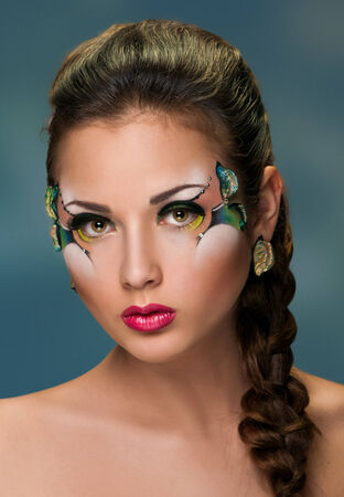 face of young woman with plait and makeup photo