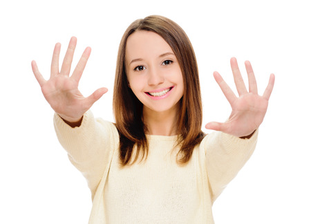 Portrait of happy smiling woman showing ten fingers, isolated over white background photo