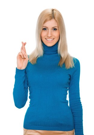 crossing fingers: young woman crossing fingers hoping for the best or sign the end Stock Photo