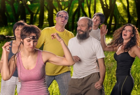 A group of practitioners of yoga dancing emotional outdoor photo