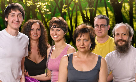 portrait woman in yoga meditation class with group of people outdoors photo