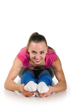 beautiful sporty woman doing exercise on the floor. on white photo